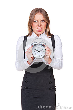 Angry businesswoman holding the clock