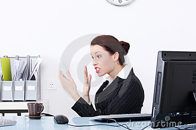 Angry businesswoman screaming to phone.