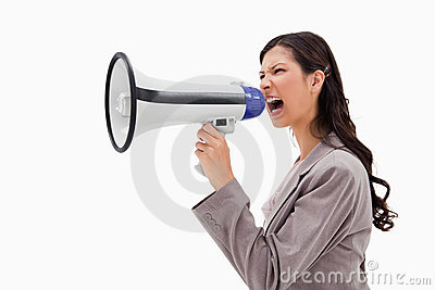 Angry businesswoman shouting through megaphone