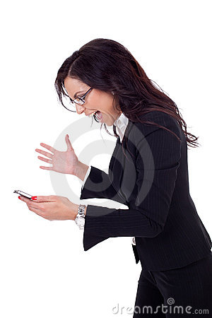 Angry businesswoman shouting to a mobile