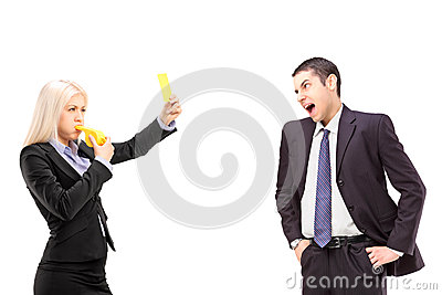 Angry businesswoman showing a yellow card to a businessman shout