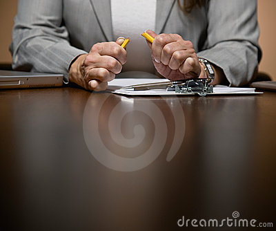 Angry businesswoman working late at desk