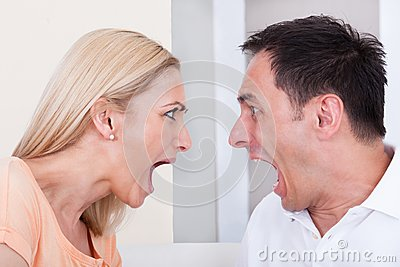 Angry couple shouting at each other