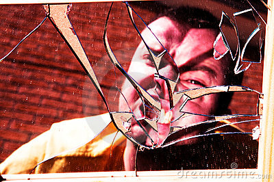 Angry face in broken glass