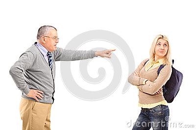Angry father reprimanding his daughter