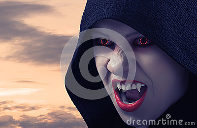 Angry female vampire at sunset