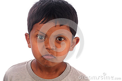 Angry, frustrated, irritated young boy(kid) isolated on white