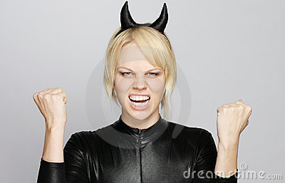 Angry girl with devil costume