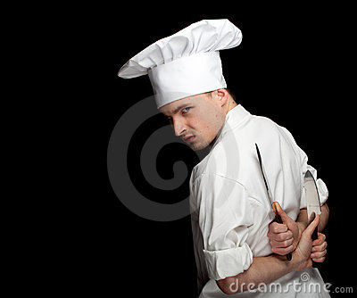 Angry male cook with two knifes