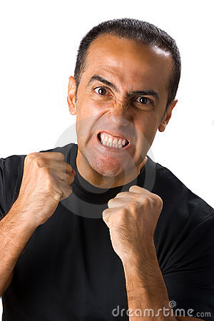 Angry man with clenched fists