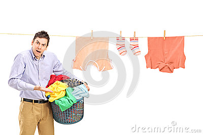 Angry man with clothes and laundry line