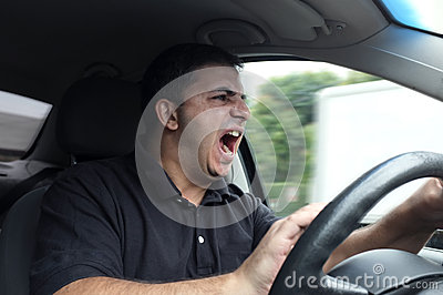 Angry man driving a vehicle