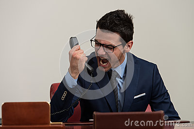 Angry Man In Formal Wear Shouting At Phone