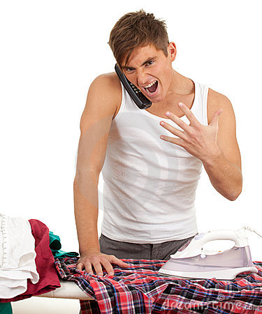 Angry man ironing clothes, housework