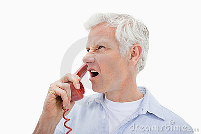 Angry man making a phone call