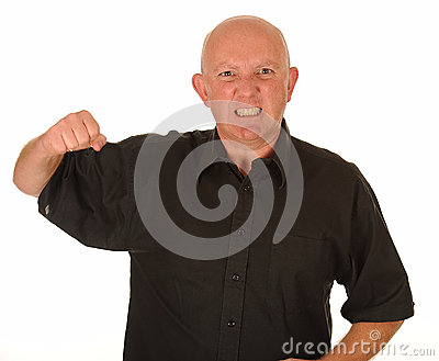 Angry man with raised fist