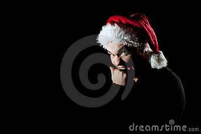 Angry man in Santa hat