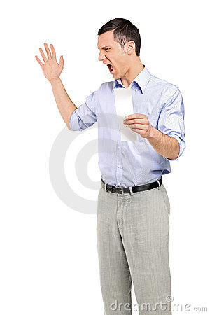 Angry man yelling after looking at store receipt