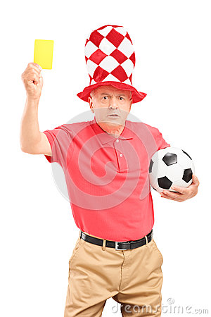 Angry mature football fan holding a yellow card and soccer ball