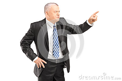 Angry mature man gesturing with finger