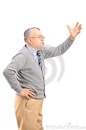 An angry mature man shouting