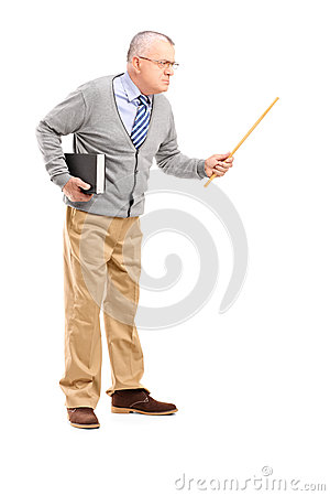 An angry mature teacher holding a wand and gesturing