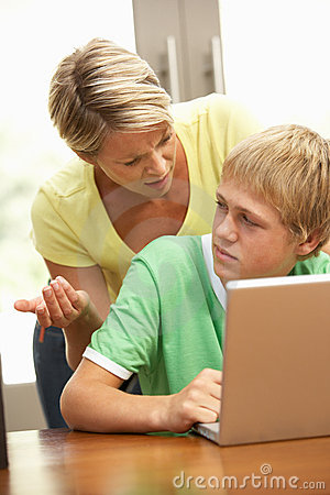 Free Angry Mother And Teenage Son Using Laptop At Home Royalty Free Stock Image - 15084436