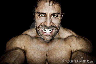 Angry muscled bodybuilding man