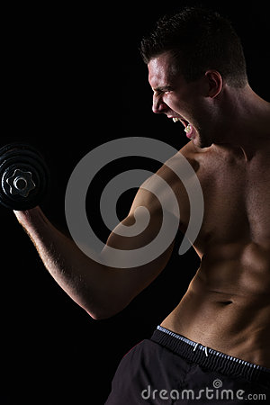 Angry muscular athlete workout biceps on black