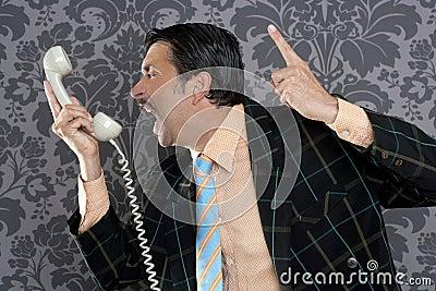 Angry nerd businessman retro telephone