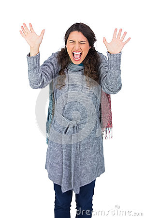 Angry pretty model with winter clothes screaming