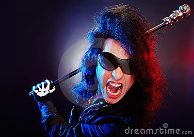 An angry rockstar screaming over dark background