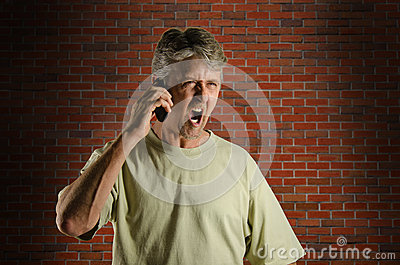 Angry screaming yelling man on a cell phone