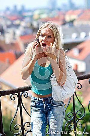 Angry teen girl with mobile phone