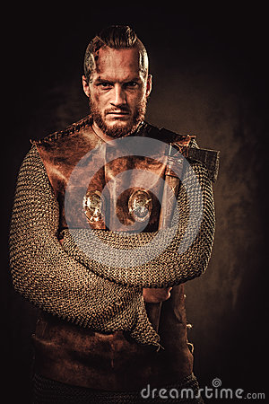 Free Angry Viking In A Traditional Warrior Clothes, Posing On A Dark Background. Stock Image - 77474711