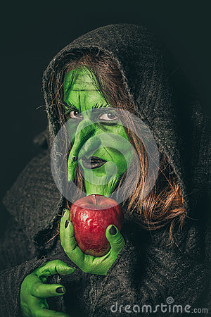 Free Angry Witch With A Rotten Apple Stock Photo - 77576830