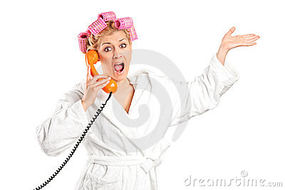 Angry woman in a bathrobe yelling on a phone