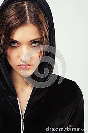 Angry woman in black hood