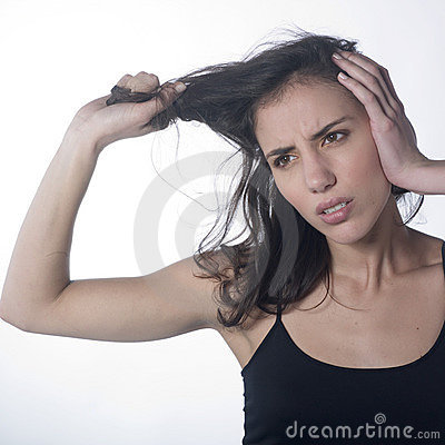 Angry woman pulling her hair