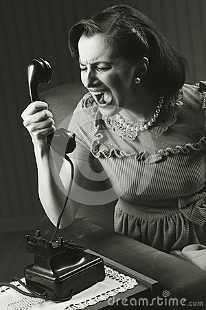 Free Angry Woman Screaming At Retro Phone Stock Images - 29870734