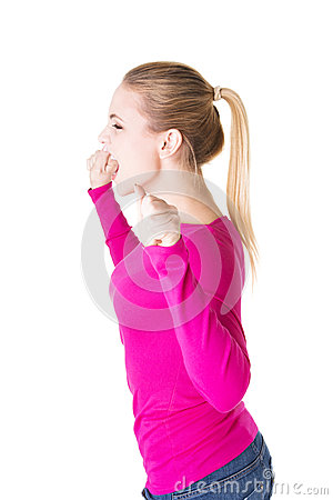 Angry woman screaming and clenching her fists.