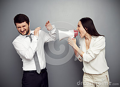 Angry woman shouting at the man
