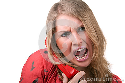 Angry woman shouting to phone