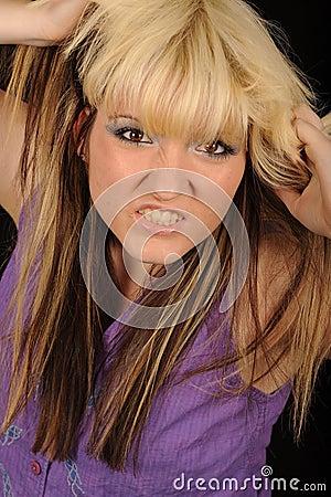 Angry woman tearing hair