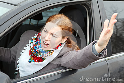 Angry woman waving hers hand and screaming