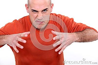 Angry young bald man
