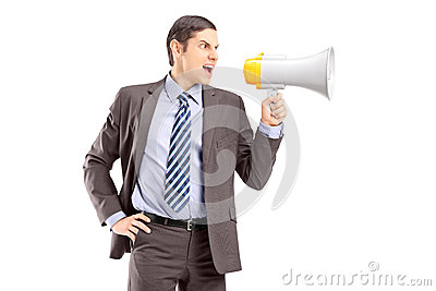 An angry young businessman announcing via megaphone
