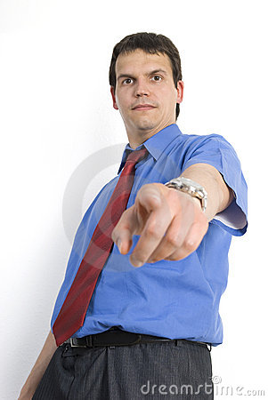 Angry  young businessman pointing down.