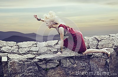 Angry young lady in a nature scenery