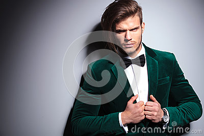 Angry young man in green velvet suit